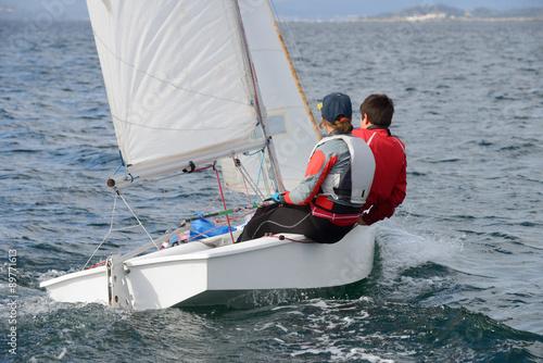 Cadres-photo bureau Voile sailor on the yacht in the sea
