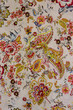texture of vintage print fabric striped flowers and paisley for