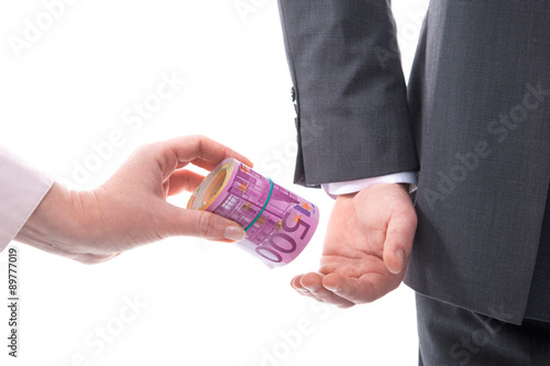 Fotomural Businessman in a suit takes a bribe
