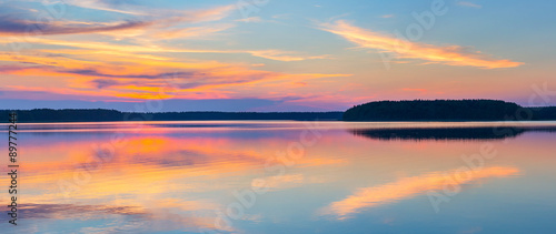 Foto op Plexiglas Blauwe jeans Sunset on a lake