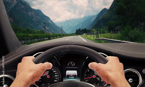 Fotografiet  Driving hands steering wheel