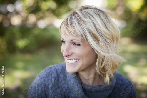 Photographie  Portrait Of A Mature Woman Smiling And Looking Away