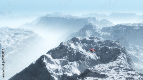Door stickers Light blue Red private airplane over misty winter mountain landscape.