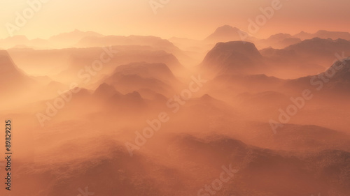 Papiers peints Corail Mountain range glowing in the mist at sunrise. Aerial view.