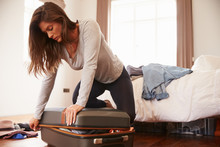 Woman Packing For Vacation Try...