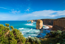 The Landmark Twelve Apostles Along The Famous Great Ocean Road, Victoria, Australia With Cliff-top Coastal Vegetation In The Foreground