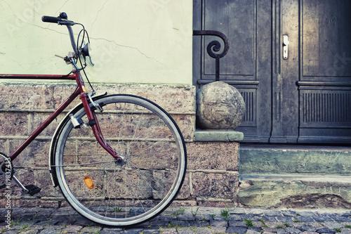 Fotobehang Fiets Wheel parked near the wall stylish bike