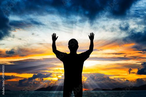 Fotografiet Silhouette man show his hands up