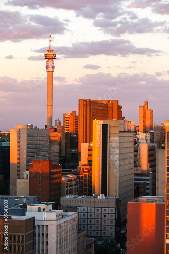 Johannesburg city bathed in afternoon sunlight. A picture of the buildings and roof tops, from the suburb of Braamfontein in the city centre.