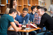canvas print picture - Friends socializing and studying together for exam