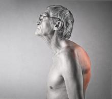 Hunchbacked Man Suffering From Backache