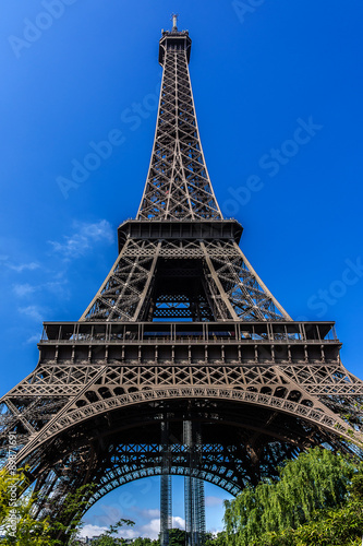 Tour Eiffel (Eiffel Tower) located on Champ de Mars in Paris. Poster