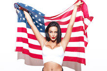 Sexy Brunette Woman With USA Flag Posing At Wall