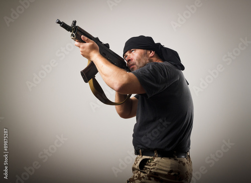 Photo Man with gun