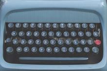 Old Vintage Blue Typewriter Keyword