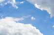 The background is a beautiful sunny sky There are not many white clouds The gap between the clouds clear sky.