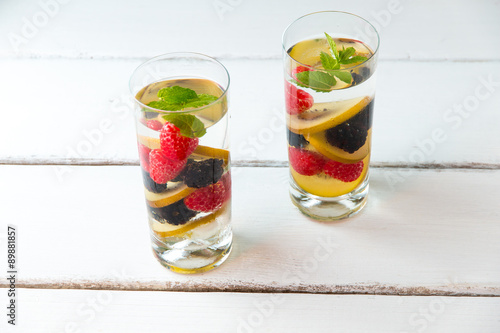 Valokuva  Infused water with  berries and golden kiwi.