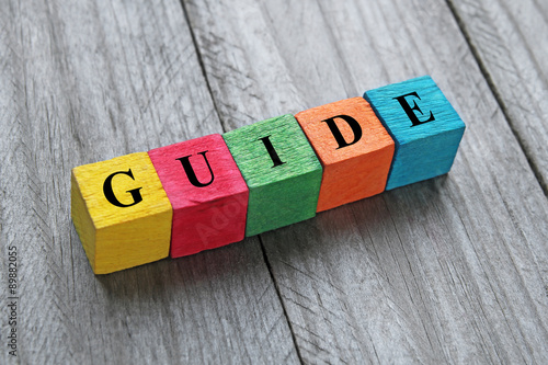 Obraz na plátně word guide on colorful wooden cubes