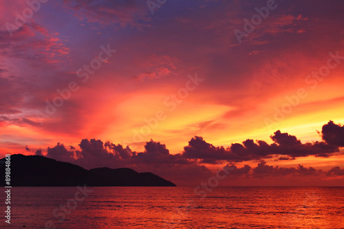 Photo Stands Crimson Dramatic seascape at sunset in Penang, Malaysia..