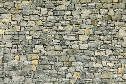 Fotobehang Stenen Background of stone wall texture