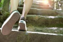 Runner Feet Climbing To Success