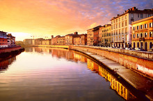 ITALY, PISA – NOVEMBER 23, 2012: Bridge Over Arno River In The Sunset. Pisa Quay.