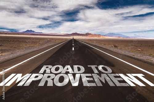 Fotografía  Road to Improvement written on desert road