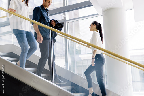 Fotografia Group of businessman walking and taking stairs