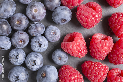 Canvas Prints Fruits Fresh ripe summer raspberries and blueberries on black slate