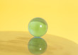 glass ball on yellow background