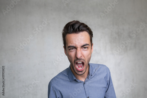 Canvas Print agressive business man shouts