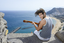 Guitarplayer/young Man Is Playing Guitar At A View Point