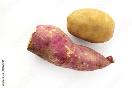 Fotografie, Obraz  Sweet And Yellow Potato on white background shot in studio.
