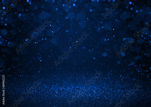 Blue sparkle glitter abstract background.
