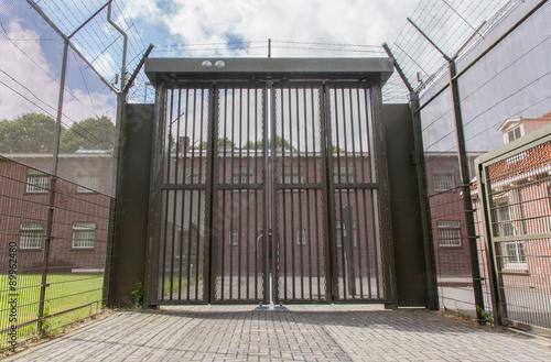 Fotografia, Obraz  Large gate at an old jail