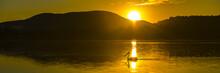 Silhouette Of A Pelican Swimmi...
