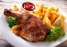 Gourmet Fries And Chicken Dish On A Plate