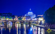 Night view over tiber river, saint peters basiica and ponte sant angelo in rome