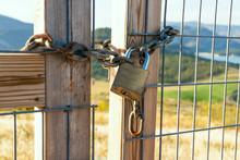 Locked Gate On Beautiful Landscape