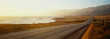 canvas print picture - This is Route 1also known as the Pacific Coast Highway. The road is situated next to the ocean with the mountains in the distance. The road goes off into infinity into the sunset.