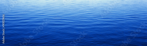 Spoed Foto op Canvas Donkerblauw These are water reflections in Lake Tahoe. The water is a deep blue and the small ripples in the water form a pattern.
