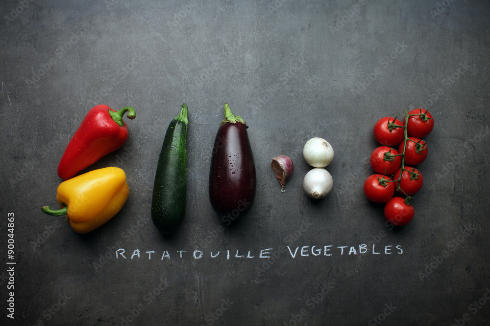 Ratatouille vegetables on kitchen table with chalk lettering