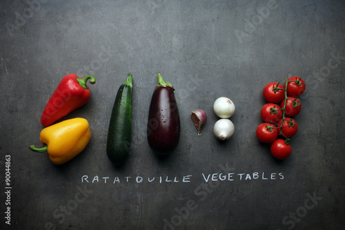 Recess Fitting Vegetables Ratatouille vegetables on kitchen table with chalk lettering
