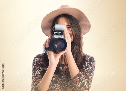 Photo  Woman with vintage video camera