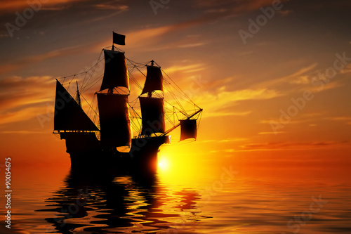 Photo Stands Ship Old ancient pirate ship on peaceful ocean at sunset.