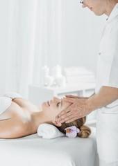 Obraz na płótnie Canvas Woman having scalp massage