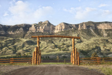 Ranch Gate And Cliffs In Wyoming, USA