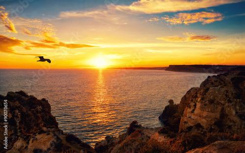 Obraz Zachód słońca nad oceanem - fototapety do salonu