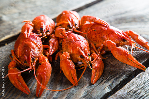 Fotografiet boiled crayfish on a wooden table