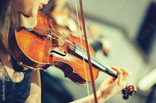 Canvas Print Symphony orchestra on stage, hands playing violin